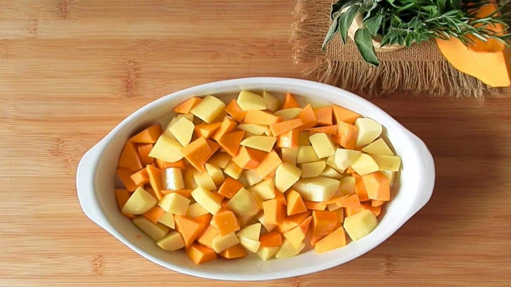 pumpkin and potatoes in a casserole dish