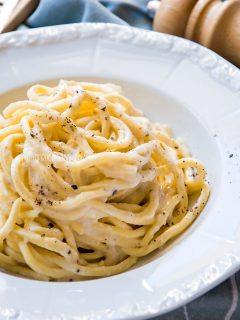 a bowl of cacio e pepe pasta