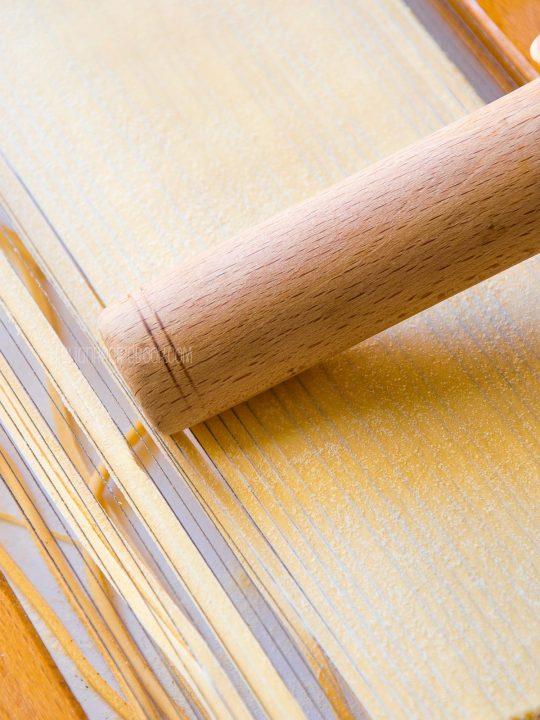 making tonnarelli with chitarra