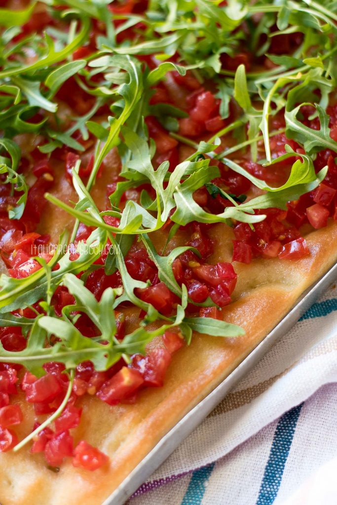 focaccia with tomatoes and arugula