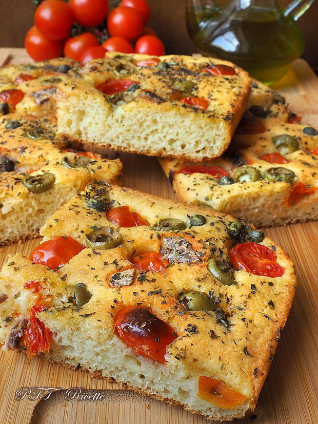 focaccia with cherry tomatoes, olives and anchovies
