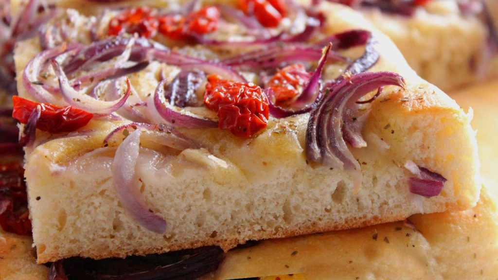 focaccia with onions and dried cherry tomatoes