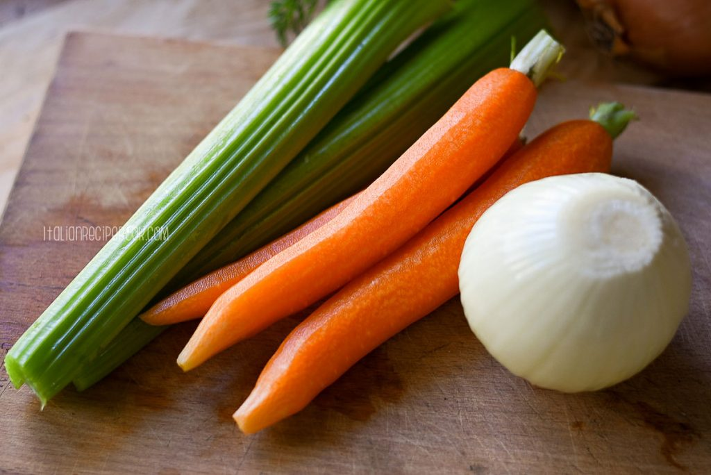washed and peeled celery, carrots and onion